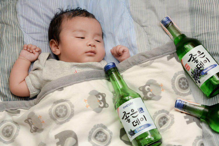 Cute baby boy lying on bed