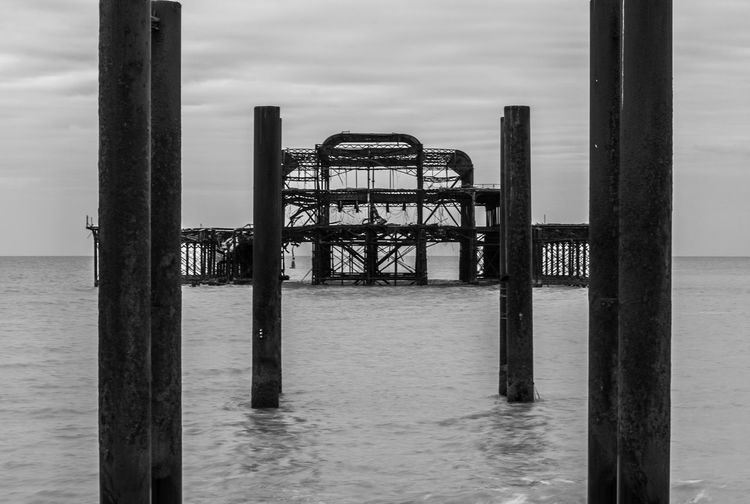 The Abandoned Pier - 1 Abandoned Abandoned Buildings Abandoned Places Feel The Journey Architecture Black And White Black And White Photography Brighton Nature No People Ocean Old Old Buildings Outdoors Pier Rippled Ruins Sea Spooky Tranquility Travel Travel Photography Traveling Water My Year My View Visual Creativity British Culture