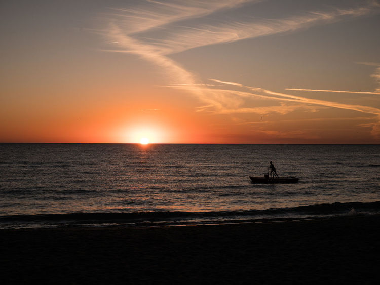 Colours Nature Quiet Beach Beauty In Nature Cloud - Sky Colours Of Nature Horizon Horizon Over Water Nature No People One Person Orange Color Outdoors Scenics - Nature Sea Ship Silhouette Sky Sun Sunset Tranquil Scene Tranquility Transportation Water