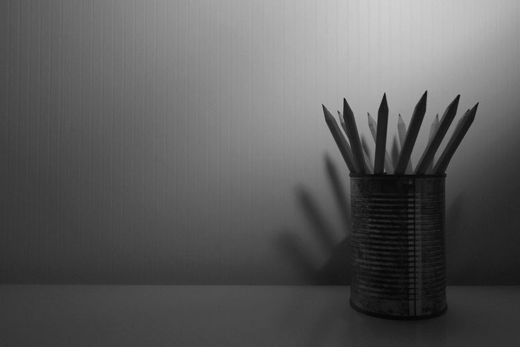 Close-up of pencils in container on table