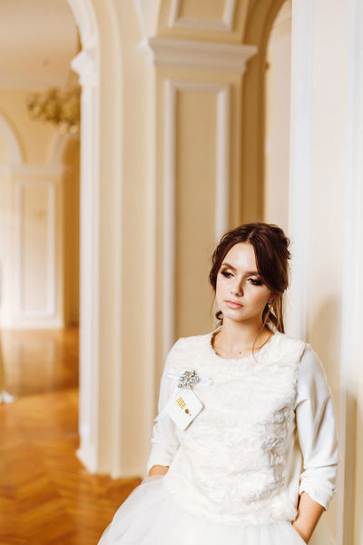 Architecture Beautiful Pure Beauty White Dress Arch Beautiful Woman Beauty Bride Building Column Day Front View Indoors  Mood Real People Sadness Standing Wedding Dress Wedding Mood White White Clothes Young Women