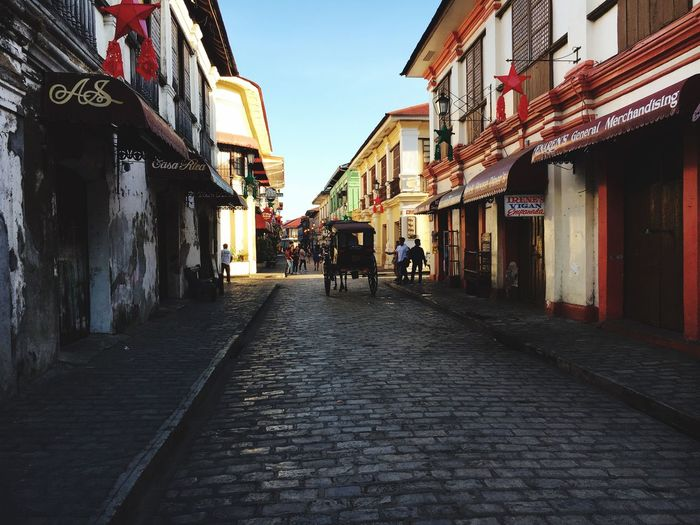Calle Crisologo Architecture Building Exterior Built Structure Street Real People The Way Forward Walking Outdoors Men Day Women Full Length Sky City People Calesa Kalesa Horse Carriage Colour Your Horizn Stories From The City