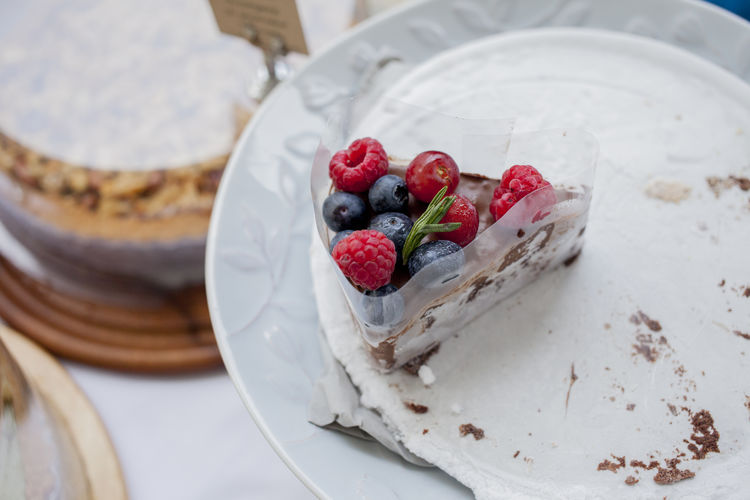 High Angle View Of Various Berries On Cake Slice In Plate
