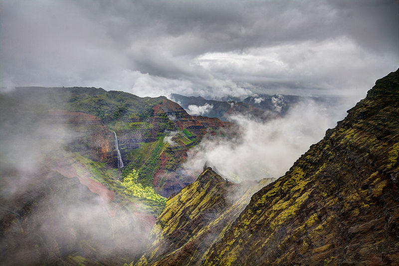 Idyllic shot of mountains in fog against sky at kauai