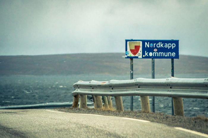 Close-up Communication Day Direction Guidance Mountain Nature No People Nordkapp Norway Outdoors Sea Sky Text Water