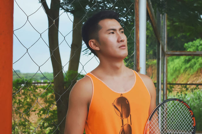 Renan Aspiras The Week On EyeEm Thedavidfotografia EyeEm Selects EyeEmNewHere Photographers On EyeEm Filipino Philippines Photographer Nature People Outdoors One Young Woman Only One Person Tennis Racket Model Orange Chinese Renanaspiras Handsome With Style