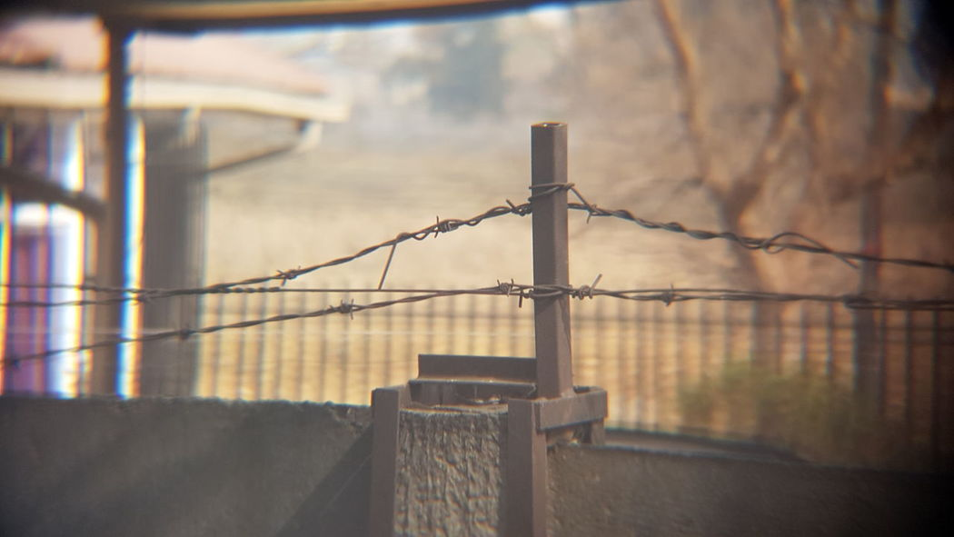 Perimeter... EyeEm Selects Protection Barbed Wire Safety Security Razor Wire Outdoors Day Confined Space City