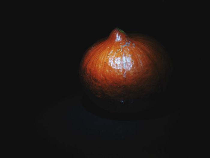 Close-up of pumpkin against black background