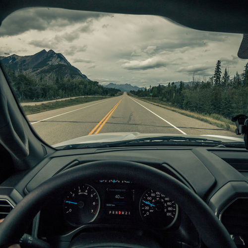 Car Car Interior Car Point Of View Close-up Cloud - Sky Dashboard Day Land Vehicle Landscape Mountain Nature No People Outdoors Road Sky Speedometer Steering Wheel The Way Forward Transportation Vehicle Interior Windscreen Windshield