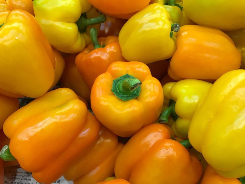 Food And Drink Bell Pepper Vegetable Healthy Eating Freshness Red Bell Pepper Yellow Bell Pepper Yellow Full Frame No People Close-up Food Backgrounds Outdoors Day
