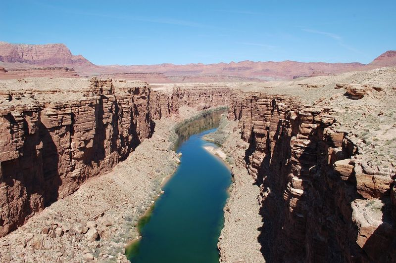 Colorado river at grand canyon national park against sky during sunny day