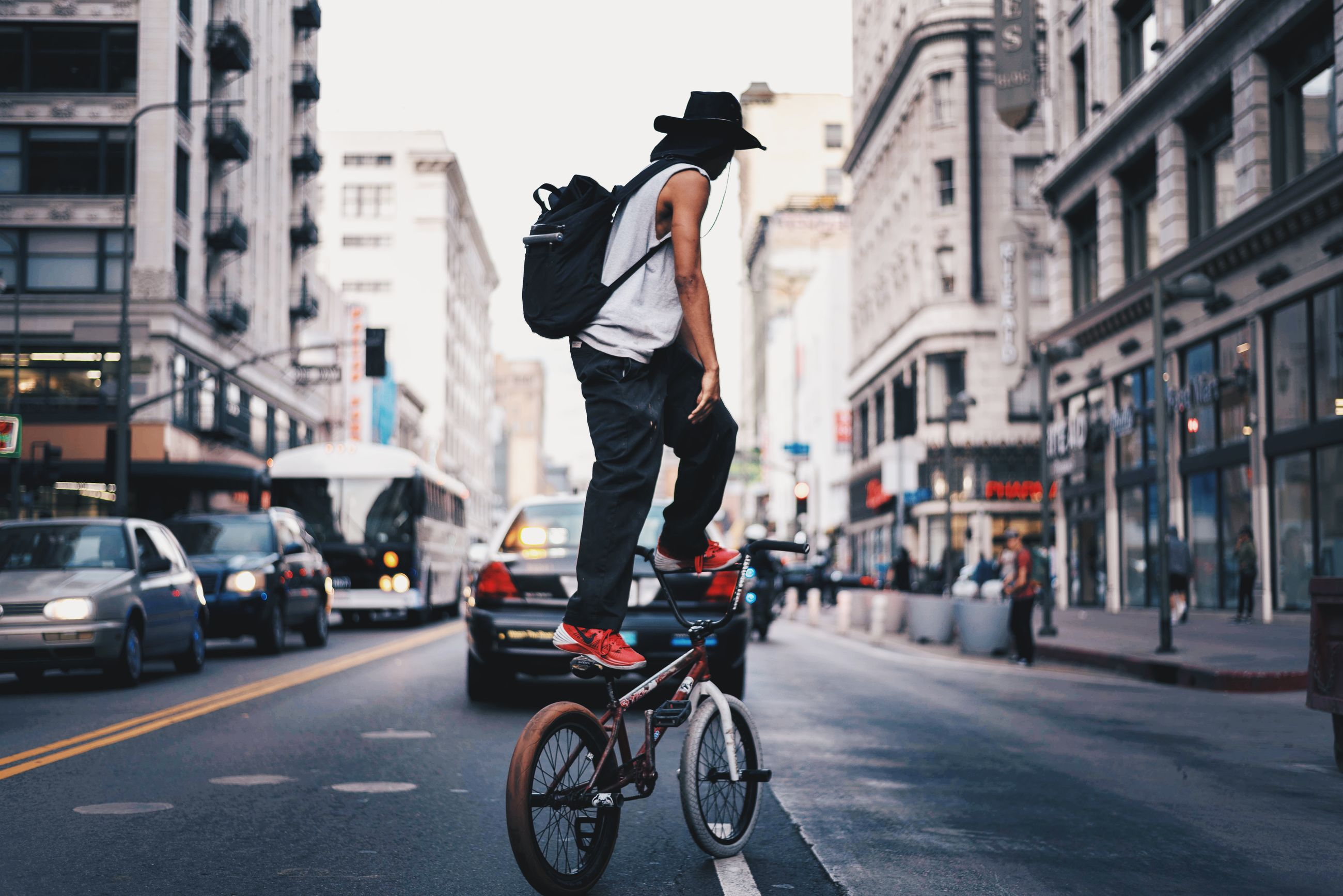 city, street, city street, one man only, city life, cycling, bicycle, adults only, men, only men, travel, travel destinations, transportation, adult, built structure, outdoors, building exterior, one person, people, day