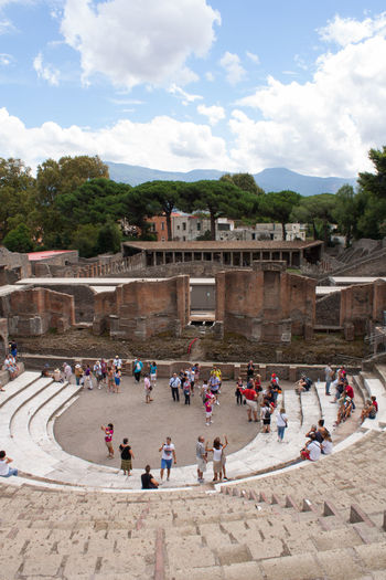 Tourists viewing the large theatre in the ruined city of Pompeii Copy Space Pompeii  Ruins Trees Architecture Building Exterior Built Structure Cloud - Sky Crowd Group Of People High Viewpoint History Large Theatre Nature Outdoors Real People Roman Sky Stone Building Theatre Tourism Tourist Travel