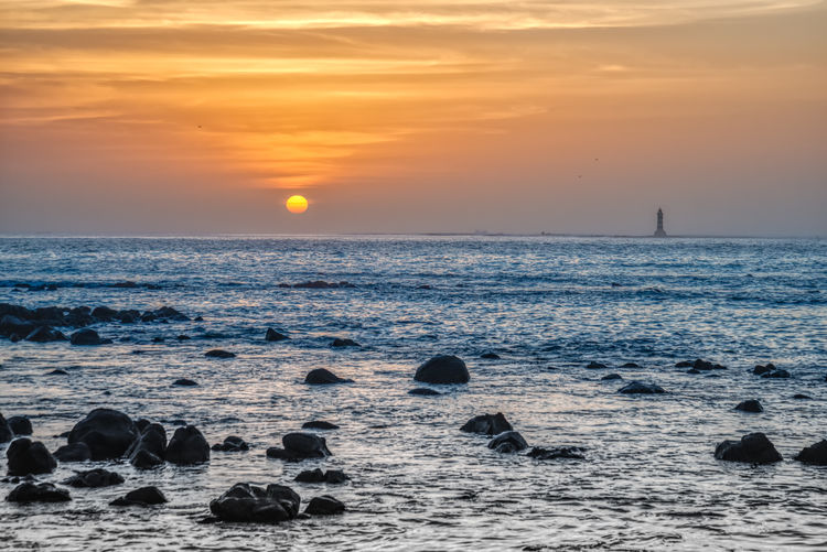 sunset and low perspective sea scape at the Almadies Sky Sunset Sea Scenics - Nature Water Beauty In Nature Horizon Orange Color Horizon Over Water Rock Sun Tranquil Scene Rock - Object Nature Tranquility Solid Beach Land Cloud - Sky No People