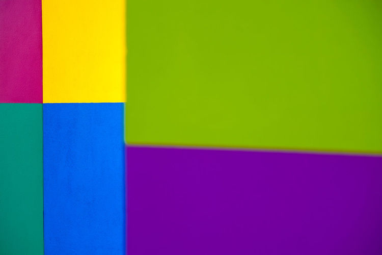 Abstract geometric pattern on concrete wall Abstract Art And Craft Art And Craft Equipment Backgrounds Blue Built Structure Close-up Copy Space Creativity Flag Full Frame Green Color Indoors  Multi Colored No People Pattern Pink Color Purple Studio Shot Vibrant Color Wall - Building Feature Yellow