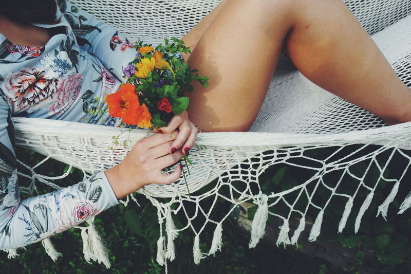 Relaxing in the hammock Hammock Relaxing Summertime Summer Vibes Summer Flowers Picking Flowers  Dress Adult Bouquet Day Floral Pattern Flower Flowering Plant Hand High Angle View Holding Human Body Part Human Hand Legs Lifestyles Midsection Nature Pattern People Plant Real People Relax Summer Two People Women
