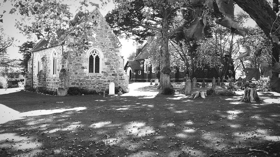 Aged To Perfection ~ Religion Spirituality Outdoors Day Place Of Worship Green Color No People Grass Nature Stone Material Church Architecture Churchyard View Knysna Cape Province South Africa Landscape Blackandwhite Graveyard Beauty Gravestone