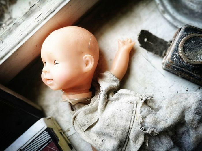 High angle view of broken doll on table