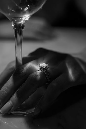Close-up of woman hand holding glass