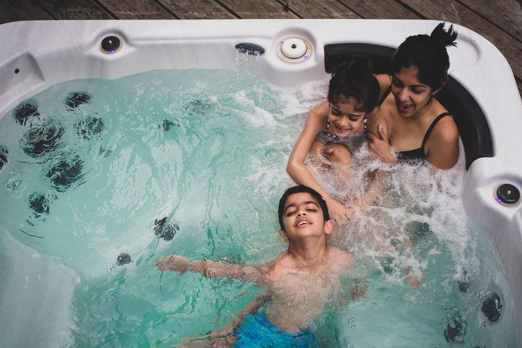 Smiling family enjoying in jacuzzi