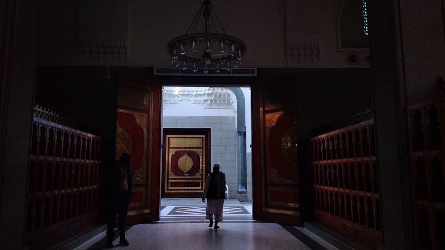 Full Length Of Men In Corridor