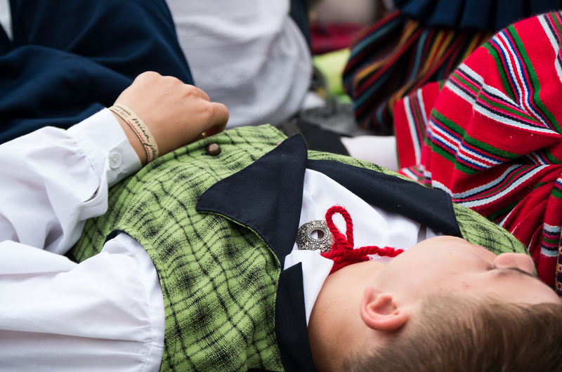 Tired boy in an Estonian folk costume resting on a ground. Blue Color Estonia Folk Costume Green Color Laulupidu Laulupidu 2017 Tradition Boy Chest Childhood Close-up Clothing Colorful Culture And Tradition Lying Down Mina Jään Real People Red Color Song Festival Summer Tire Traditional Traditional Festival Vest White Color The Week On EyeEm