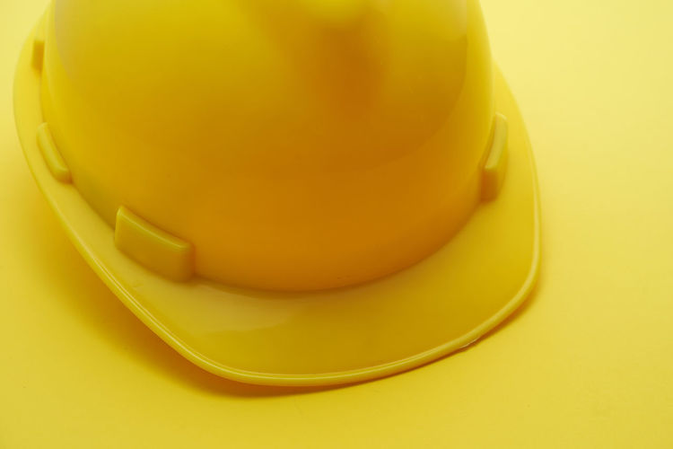 High angle view of yellow juice on table