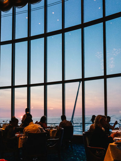 Sunset in ship restaurant Architecture Built Structure Cruise Cruise Ship Enjoyment Full Frame Glass Glass - Material Indoors  Lifestyles Light Modern Pattern Reflection Repetition Restaurant Ship Sunset Togetherness Transparent View Window