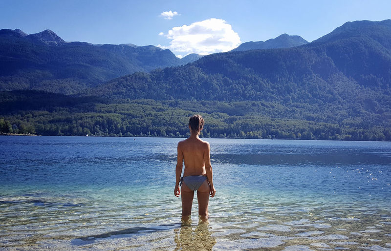 amazing view from the lake i stand in Adult Adults Only Beach Beauty Beauty In Nature Cloud - Sky Day Health Spa Landscape Mountain Nature Nudists One Person Outdoors People Real People Rear View Scenics Sea Sky Standing Travel Destinations Vacations Water Young Adult