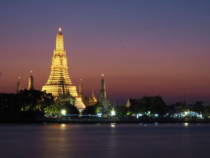 Temple in Thailand. Buddha Twilight Twilight Time Twilight Hour Temple Templephotography City Cityscape Urban Skyline Sunset Statue Place Of Worship Skyscraper Arts Culture And Entertainment Gold Ancient