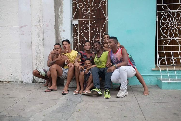 Bonding Casual Clothing Cuban Family Family Full Length Lifestyles Sitting Togetherness Young Adult