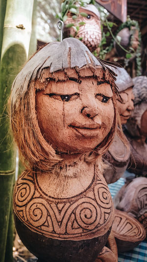 Coconut Art And Craft Brown Carved Carved Wood Close-up Craft Creativity Focus On Foreground Hand Made No People Outdoors Representation Toy