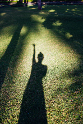 Shadow of man on golf course