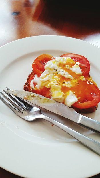 Tomato, poached egg, smoked salmon spread and sunshine on wholegrain bread
