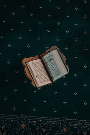High angle view of old book on table