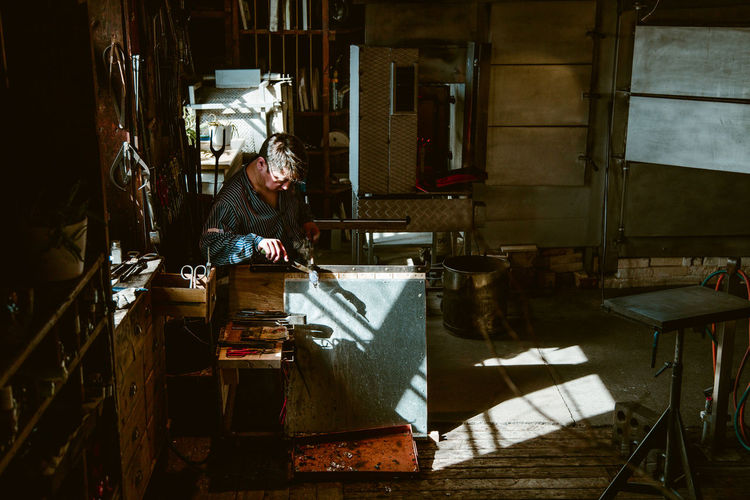 the glassblower Glassworks Glassworker Worker Craftsman Craft Studio Workshop Workbench Dark Wood Light Light And Shadow Foundry Instrument Maker Carving - Craft Product Craftsperson Art Studio