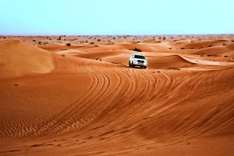 Adventure Arid Climate Backgrounds Beauty In Nature Clear Sky Day Desert Environment Extreme Terrain Landscape Motorsport Nature No People Outdoors Pattern Sand Sand Dune Scenics Sky Tire Track Lost In The Landscape