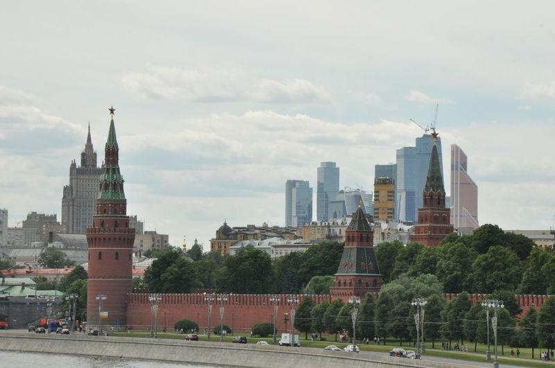 Corner arsenalnaya with kremlin wall by road in city