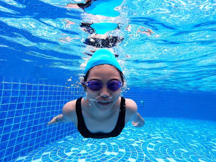 Portrait of girl swimming in pool