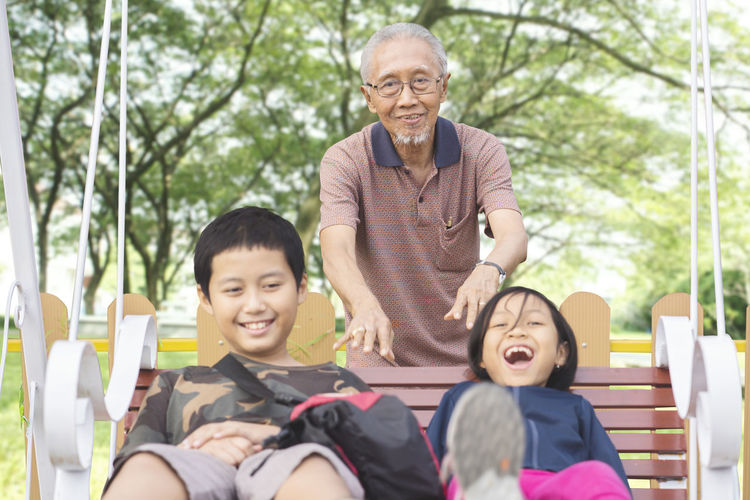 Adult Bonding Casual Clothing Child Childhood Family Grandchild Grandfather Males  Men Multi-generation Family Outdoors Portrait Real People Senior Adult Senior Men Sitting Smiling Togetherness Two People Women