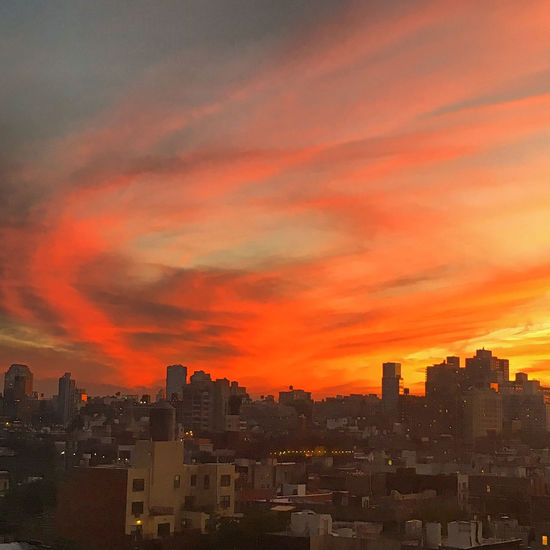 The sky after the storm Architecture Beauty In Nature Building Exterior Built Structure City City Life Cityscape Cloud Cloud - Sky Cloudy Dramatic Sky Nature No People Orange Color Outdoors Residential Building Residential District Residential Structure Scenics Sky Sunset Weather