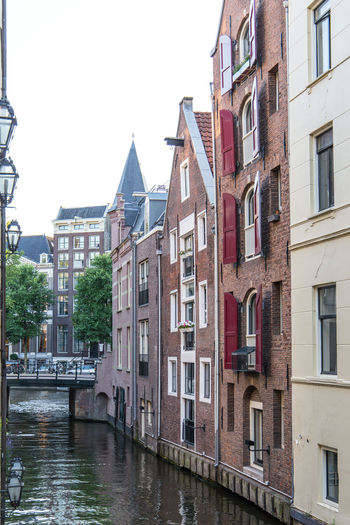 Amsterdam Netherlands Architecture Building Building Exterior Built Structure Canal City Clear Sky Day Dutch Architecture Dutch Houses Holland House In A Row Nature No People Outdoors Residential District Row House Sky Water Waterfront Window
