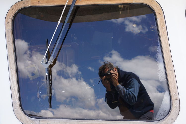 Reflection of man on car window