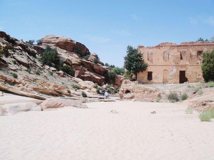 Old ruins at desert against blue sky