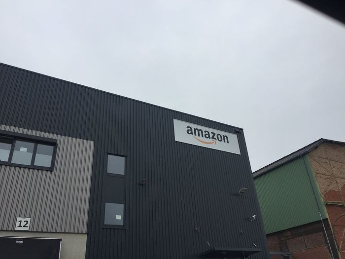 Berlin, Germany - March 26, 2018: Amazon signage outside the facade of the logistics center. Founded in 1994, Amazon is an American electronic commerce and cloud computing company of online shopping Logistics Amazon Architecture Building Exterior Built Structure Communication Low Angle View No People Online  Online Shop Online Shopping  Onlineshop Onlineshopping Onlinestore Outdoors Shopaholic Text Warehouse Western Script