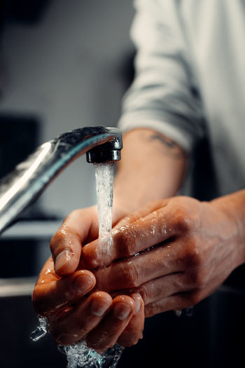 Close-up of person hand holding water