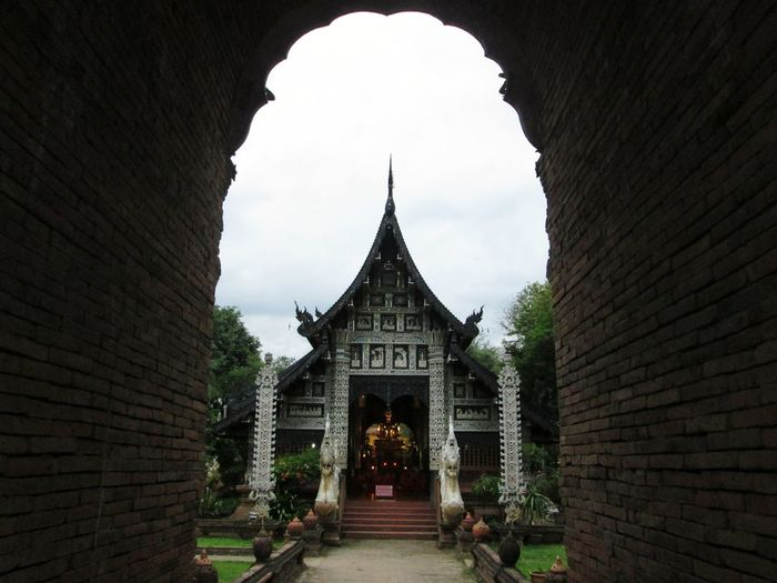 View of Wat Lok Molee through antique arch wall structure frame. Chiangmai South East Asia Antique Architecture Arch Frame Temple Lanna Temple Thailand Archway Historic Entrance Ancient