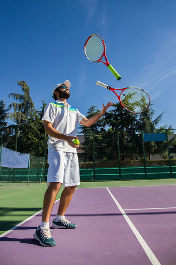 Man playing tennis at court