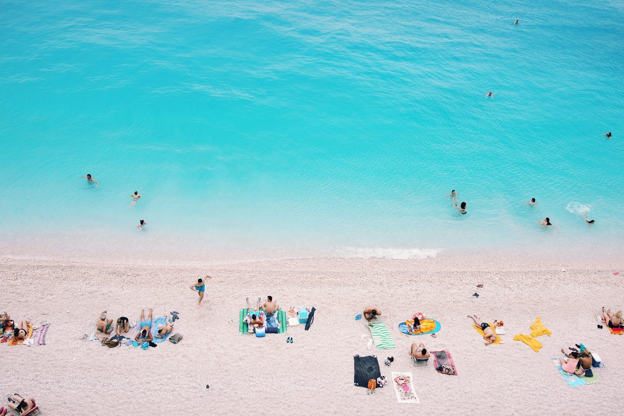 High Angle View Of People Relaxing At Beach