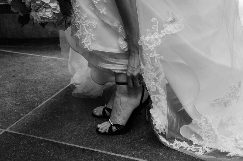 Low section of bride adjusting heels
